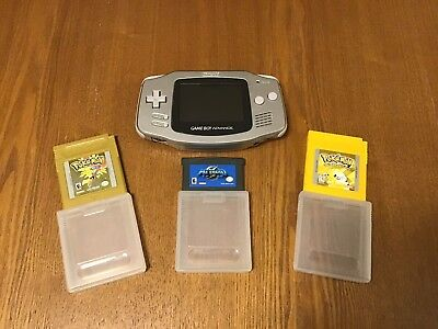 Silver Gameboy Advance with Metroid Fusion Pokemon Yellow and Pokemon Gold