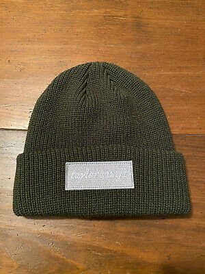 Taylor Swift in from the snow green beanie Official Evermore Merchandise