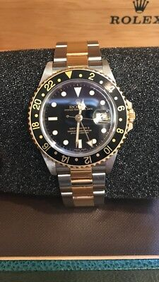 Rolex 2004 GMT master II 16713 18k Yellow Gold - Stainless Steel 40mm