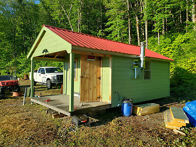 41-4 Acres on the US Canadian border in Maine with a tiny cabin and great view