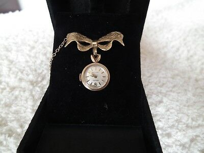 Unique Ladies Gold Brooch with Rolex watch nurses style