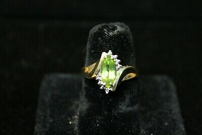 10K Yellow Gold Peridot Ring with 8 Diamond Accents- size 6-5