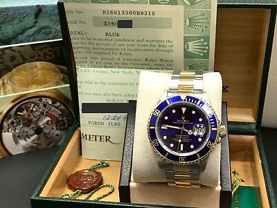 Rolex Submariner Blue 16613 18K Yellow Gold - Stainless Steel Box - Papers