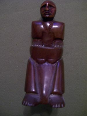WOOD CARVING OF A MAN SITTING