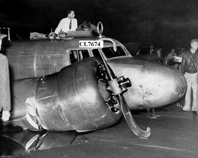 Amelia Earhart Inspects Her Damaged Lockheed Electra 10E in Pearl Harbor Photo
