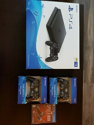 Brand New Sony PlayStation 4 1TB Black Console with three controllers- Game