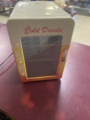 Refreshing ice cold drinks Thermo electric cooler and warmer- Retro READ