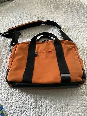 Briggs and Riley carry on Bag Orange Canvas With Black Trim Great Condition