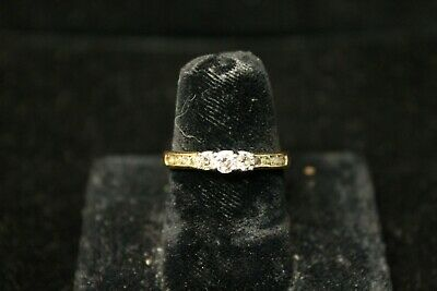 10K Yellow Gold Ring With 3 Center Diamonds- Diamonds in Band Size 7