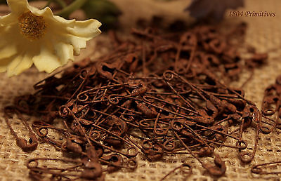 100 Primitive Itty Bitty 34 RUSTY Safety Pins  Rusted