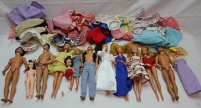 Huge lot of Vintage 13 Barbies Ken dolls and others with clothes 1966 1967 1968