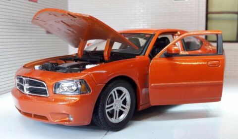 G 1 24 SCALE DODGE CHARGER DAYTONA R T 2006 ORANGE WELLY DRUCKGUSS MODELL AUTO