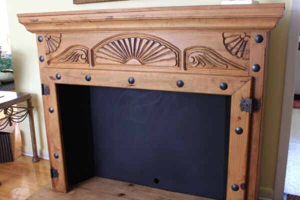 Wood Fireplace Mantel with Carved Design and Metal Decor $595.00
