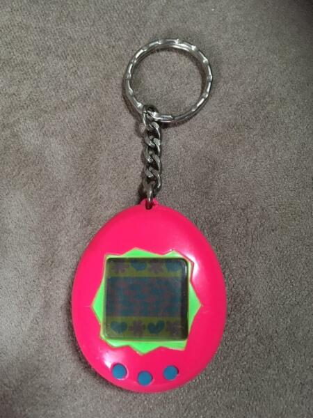 Tamagotchi P1 Virtual Pet Pink w/ Green 1997