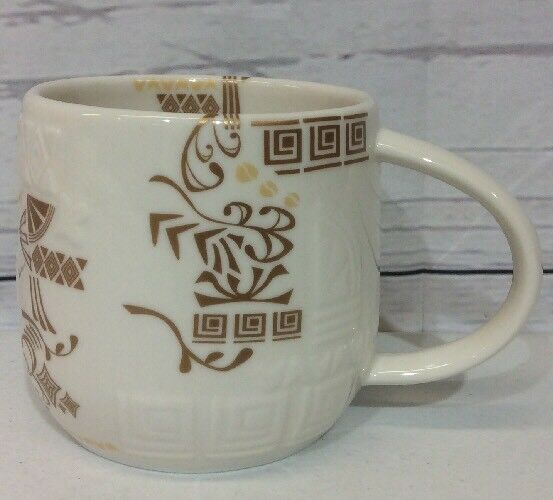 Starbucks 2012 Coffee Mug Cup Oriental Theme Gold and White Embossed