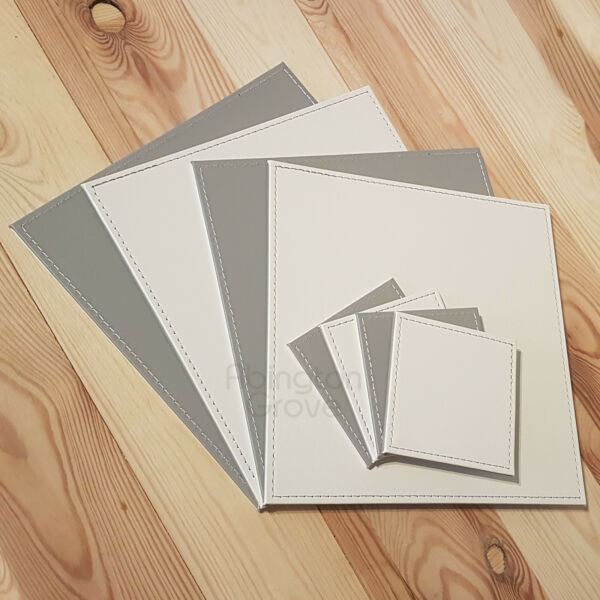 Set of 8 Faux Leather Placemats & Coasters Reversible White & Grey Table Mats