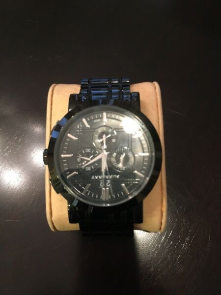 Burberry watch round black face with black link band $169.00