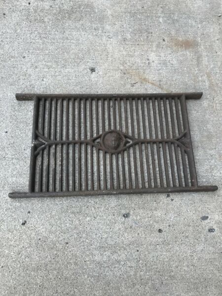 Antique cast iron grate heavy with face 17.5 x 11.5