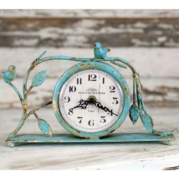 Vintage Style Mantel Clock Featuring A Bird And Branch Design