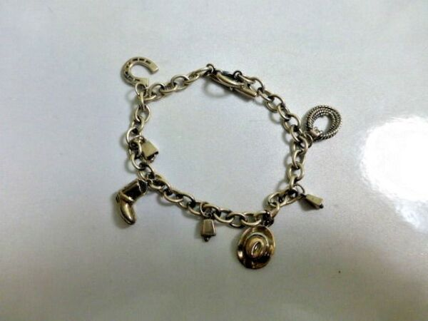Sterling Silver Charm Bracelet New Old Stock Sold At The BonMarche'