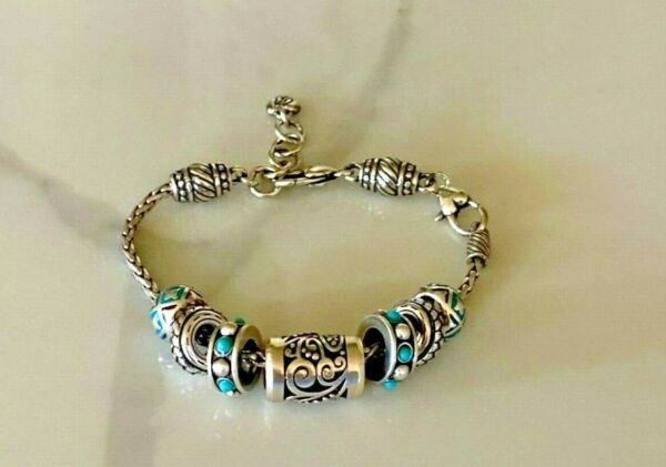 NWOT Brighton Barrel Charm Bracelet With 7 Silver Scroll Aqua Blue Slide Charms $63.00