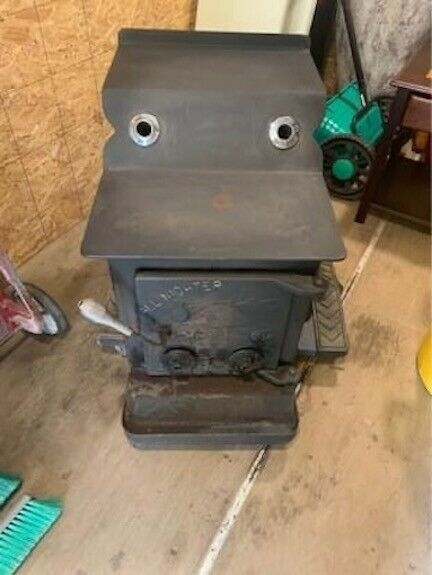 ALL NIGHTER MID MOE WOOD STOVE. NICE CLEAN WORKING STOVE $600.00