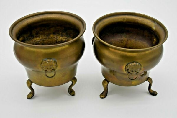 Vintage Pair of Small Brass Footed Jardinière Planters with Lion#x27;s Head Accents