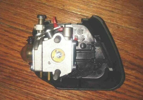 Carburetor from Craftsman 2 cycle gas 25cc Weedeater with housing