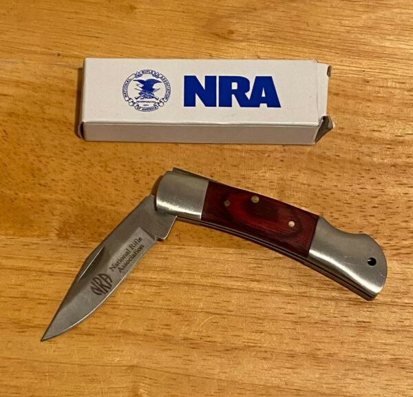 NRA Knife CM1300145 single blade wooden inlayed handle 2 1 2quot; blade $10.00