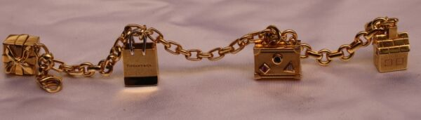 MAGNIFICENT 18K TIFFANY & CO. CHARM BRACELET WITH BOX