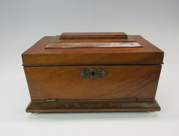 Unusual antique inlaid wood tea caddy box with key front opens. Needs some TLC