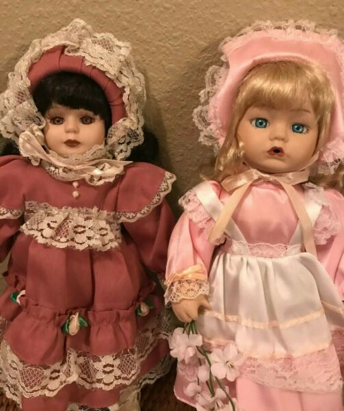 Two Vintage sweet porcelain dolls in Victorian garb collectible