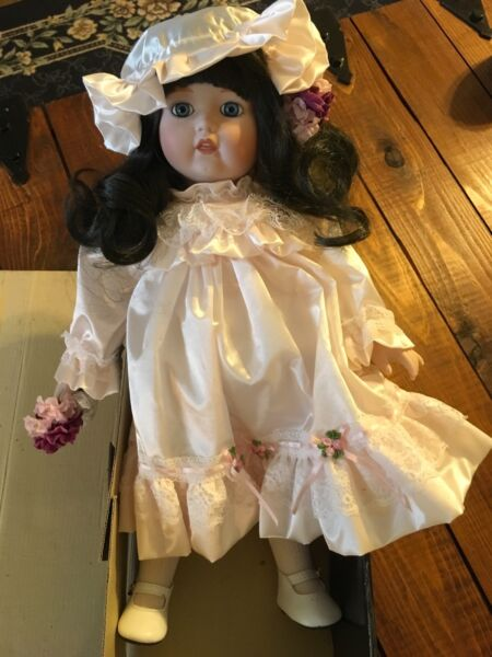 Joan 17 inch porcelain with Black hair in light pink satin dress by Anna's Doll