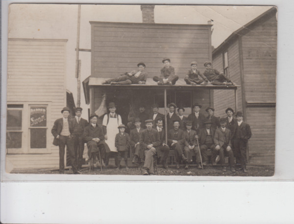 RPPC - Cambria IA - Men posing outside Barber Shop - early 1900s