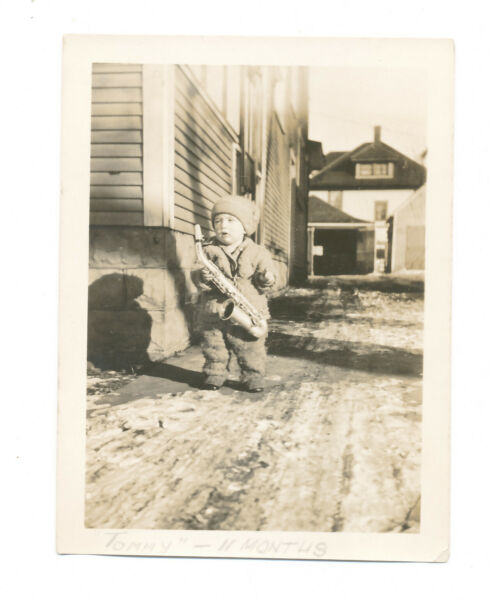 B23 VINTAGE PHOTO BOY HOLDING SAXAPHONE IN WINTER quot;TOMMY 11 MONTHSquot; $4.95