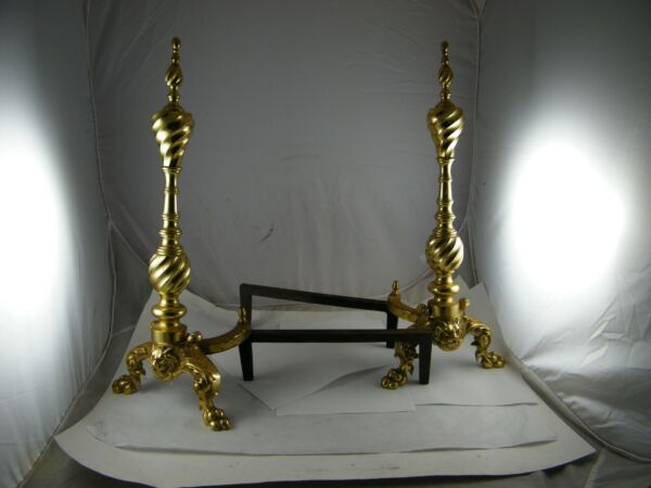 VINTAGE BRASS AND CAST-IRON FIREPLACE ANDIRON LION HEAD AND FEET