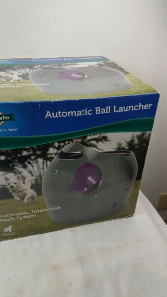 PETSAFE AUTOMATIC BALL LAUNCHER FOR DOGS.  VERY NICE WORKS GREAT 4 BALLS $100.00