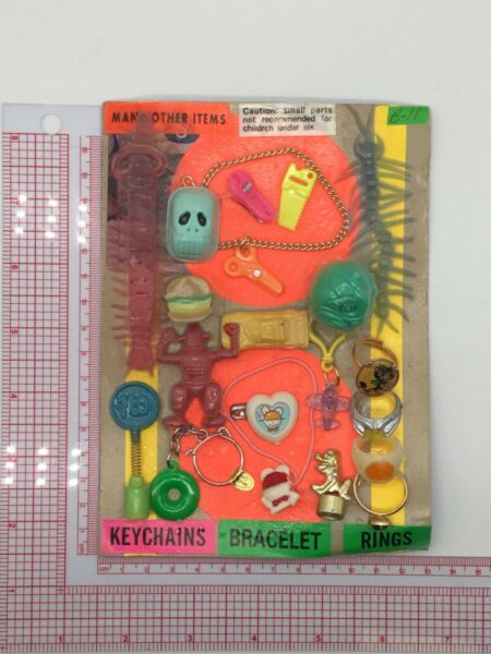 Plastic Toy and Charm Assortment Gumball Vintage Vending Display Card CD55 $29.99