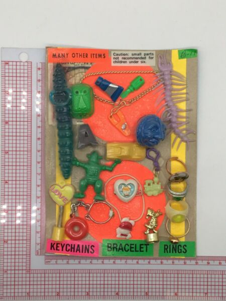 Plastic Toy and Charm Assortment Gumball Vintage Vending Display Card CD57 $29.99