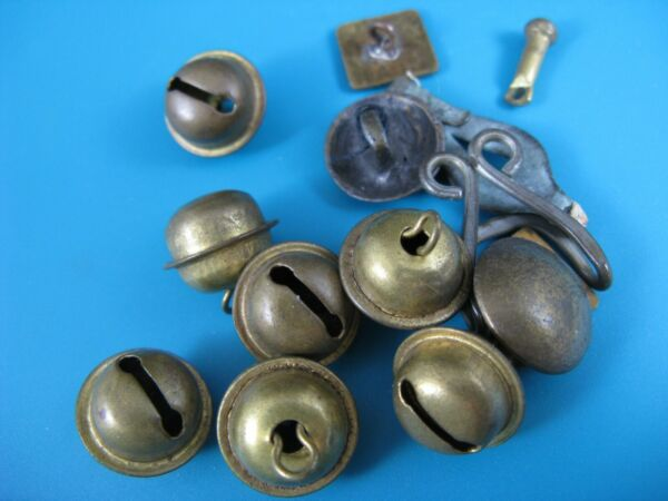 7 small antique BELLS AND OTHER BRASS CLOTHING ITEMS