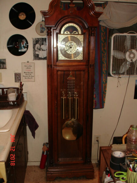 1994 Howard Miller tall case grandfather clock. Looks and works great. Factory a