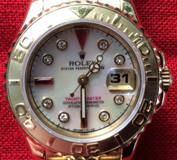 ROLEX LADIES 18K GOLD YACHTMASTER-MODEL 69628-ALL BOXES HANG TAGS