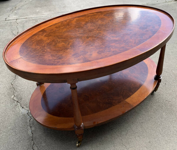 Henredon Acquisitions Burl Wood Two Tier Oval Wheeled Coffee Table
