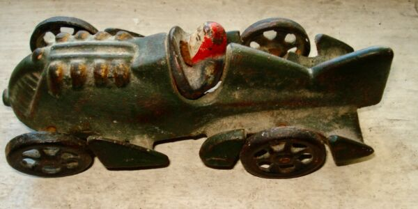 old cast iron racing car with driver