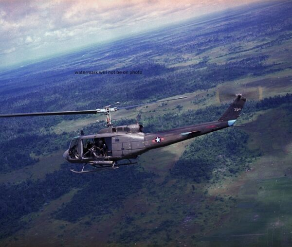 Bell UH-1H Huey Helicopter in flight 8