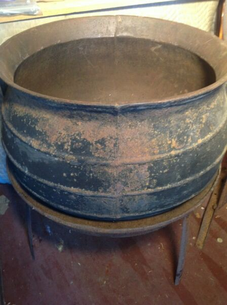 old iron pot on stand