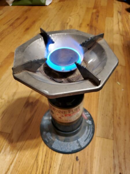 Coleman Single Burner Stove With Empty Propane Tank and Base.