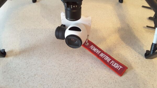 DJI Inspire 1 X3 camera gimbal lock with Remove Before Flight keyring.