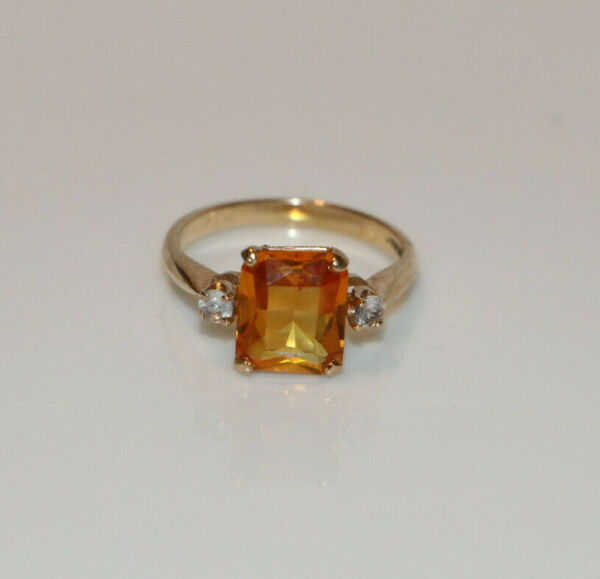 Baden & Foss Emerald Cut Yellow Orange Sapphire With Colorless Topaz Accents