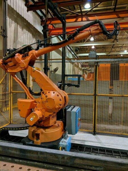 ABB IRB 4400L30 with IRC5 30 ft track plasma cutting system W burning tables